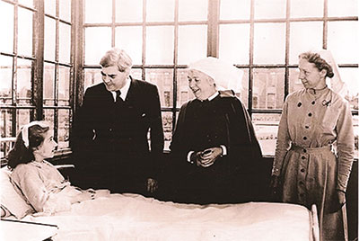 Bevan seeing a patient on a ward